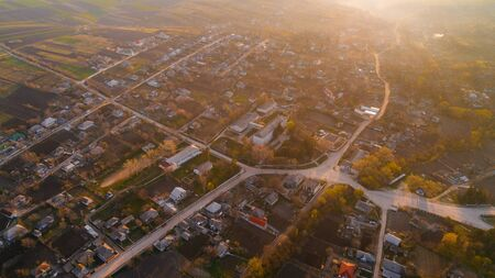 A beautiful village at sunrise, shot from above.