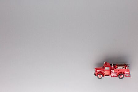 A red truck figurine, shot from above, white background. 版權商用圖片
