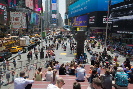 times square new york: Tourists and locals enjoy summer weather on the steps of Times Square, New York