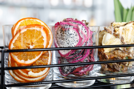 Slices of dried fruit. Orange, Dragon fruit and pineapple. Natural organic vegetarian food.