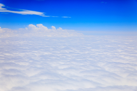 Skyline View above the Clouds from air plane - Travel concept