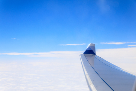 where to go: View of beautiful cloud and wing of airplane from window
