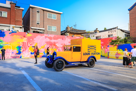 Untitled tourists visit the parking lot that displays the historic yellow car of Louis Vuitton on Jun 19, 2017 in Samcheong-Dong, Seoul city, Korea - Tour destination
