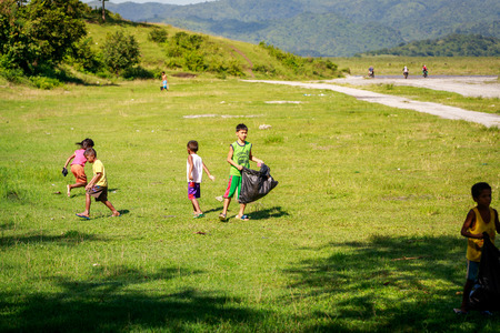 Children picking up trash near Mount Pinatubo on Aug 27, 2017 in Santa Juliana, Capas, Central Luzon, Philippines