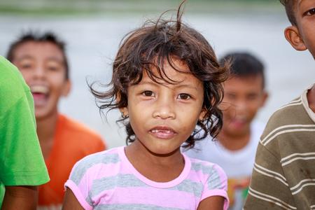 Portrait of Aeta tribe little girl near Mount Pinatubo on Aug 27, 2017 in Santa Juliana, Capas, Central Luzon, Philippines.