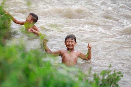 Filipino children swimming in the river on Aug 27, 2017 in Santa Juliana, Capas, Central Luzon, Philippines.
