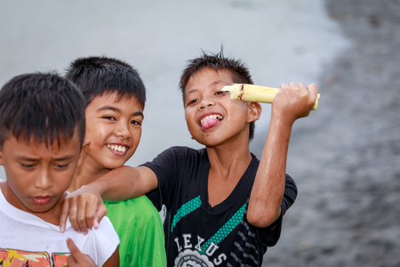 local 27: Local Filipino children living near volcano Mount Pinatubo on Aug 27, 2017 in Santa Juliana, Capas, Central Luzon, Philippines. the people suffer of poverty due to the bad economy, political issue.