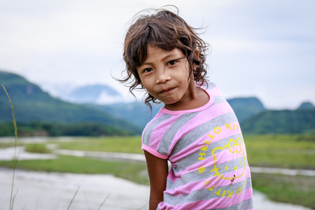 Portrait of Aeta tribe little girl near Mount Pinatubo on Aug 27, 2017 in Santa Juliana, Capas, Central Luzon, Philippines. the people suffer of poverty due to the bad economy, political issue.