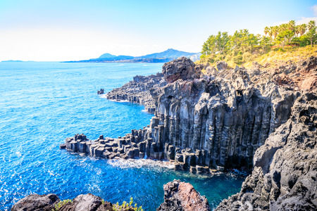 The Daepo Jusangjeolli basalt columnar joints and cliffs on Jeju Island, South Korea Stock fotó