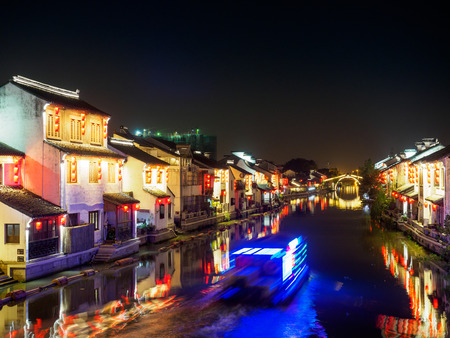 Night scene of Nanchang ancient street. Nanchang - historic scenic town (a canal, boats, historic houses and chinese lanterns) on Nov 11, 2017 located in Wuxi Shi, China