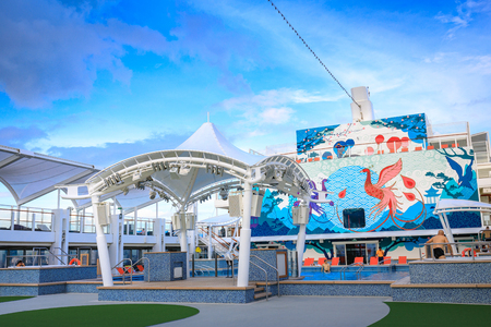 Main Pool deck facility with beach seats of Dream Cruises sailing away from Hong Kong on Nov 21, 2017 at port of Manila, Philippines