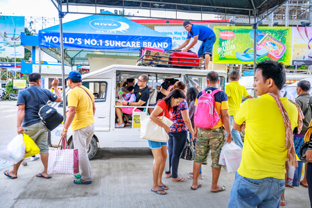 People who ride the jeepney to go to Boracay main destination on Nov 17, 2017 at Cagban Jetty Port in the Philippines. Stock Photo - 92004306