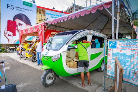 People who ride the green electric car to go to Boracay main destination on Nov 17, 2017 at Cagban Jetty Port in the Philippines.