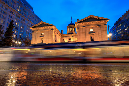 Pioneer Courthouse with tram trail on a rainy winter night, which is the oldest federal building in the Pacific Northwest. Stock Photo