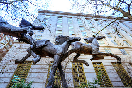 Portland, Oregon, United States - Dec 19, 2017: Three running horses statue at The Gus J. Solomon United States Court House in downtown Portland
