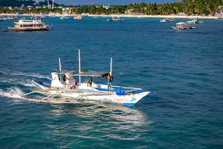 BORACAY ISLAND, PHILIPPINES - November 18, 2017 : Hopping, Dive boats in the Boracay sea Redakční