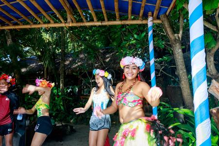 BORACAY ISLAND, PHILIPPINES - November 19, 2017 : Happy filipino portrait dancing at Crystal Cove in Boracay Island