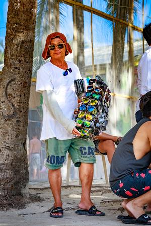 BORACAY ISLAND, PHILIPPINES - November 19, 2017 : Beach sunglasses seller in Boracay island