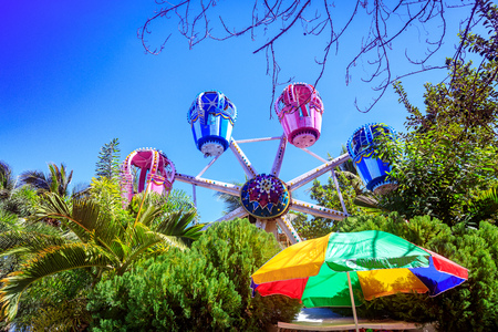 BORACAY ISLAND, PHILIPPINES - November 18, 2017 :  The Ferris wheel, which meets the blue sky, is circling among the trees at D-mall in Boracay Island Editorial
