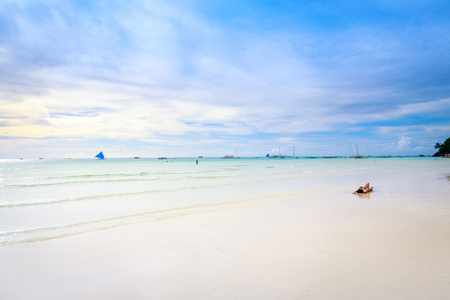 Tropical background with white sand beach, blue sea and perfect sky