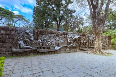 Manila, Philippines - Feb 4, 2018 : The Martyrdom of Dr. Jose Rizal wall metal statues in Rizal Park, Manila