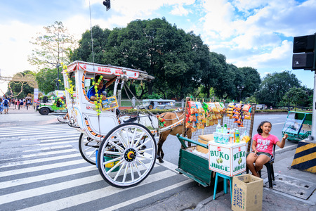 Manila, Philippines - Feb 4, 2018 : Horse with carriage in Intramuros, Manila, Philippines. Intramuros is the oldest district and historic core of Manila capital of the Philippines.