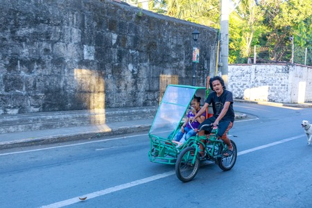 Manila, Philippines - Feb 17, 2018 : A man riding bicycle at Intramuros district, Manila city