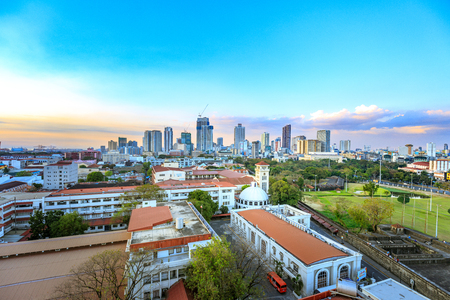 Manila city skyline in Philippines. Seen from Intramuros district.