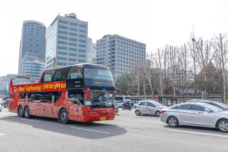 Seoul, South Korea - March 6, 2018 : Seoul Sightseeing Bus passing through Seoul City Hall Station