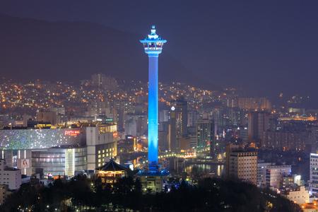 Busan city skylight and Busan tower at night in Korea Редакционное