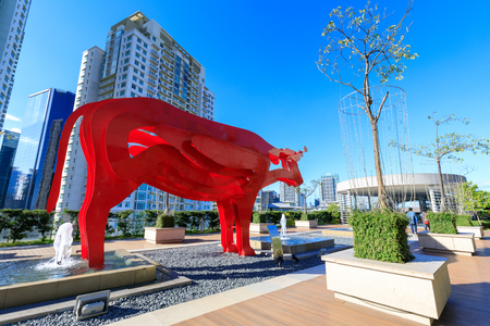 Manila, Philippines - Feb 24, 2018 : Red carabao sculpture at SM Aura Premier, Shopping mall in Taguig, Philippines Redakční