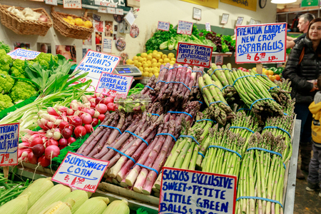 Seattle, Washington - April 9, 2018 : Fresh Fruits and Vegetables Shop on display at Public Market Center also known worldwide as Pike Place Market, Seattle landmark