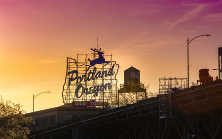 Portland, Oregon, USA - April 24, 2018 : Sunset over the iconic Portland, Oregon Old Town sign in downtown Portland, Oregon Editorial