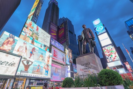 New York, USA - May 6, 2018 : Times Square, featured with Broadway Theaters and animated LED signs, is a symbol of New York City and the United States.