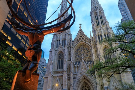 New York, USA - Atlas statue and St. Patricks Cathedral at night located in Fifth Avenue, Manhattan, NYC