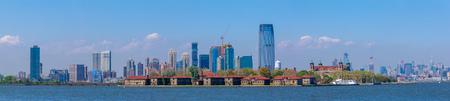 Beautiful Ellis Island with Jersey City background skyline from Liberty Island, NYC