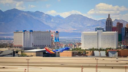 Las Vegas, Nevada - May 29, 2018 : Southwest airline at McCarran Airport with Vegas skyline in Las Vegas, Nevada. Editorial