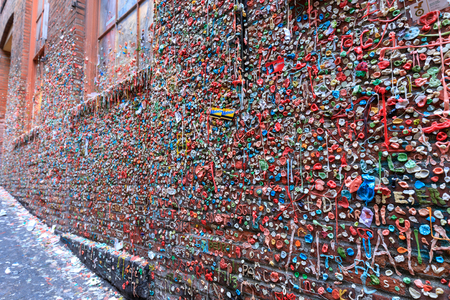 Seattle, Washington - June 30, 2018 : The Market Theater Gum Wall in downtown Seattle. It is a local landmark in downtown Seattle, in Post Alley under Pike Place Market. Editöryel