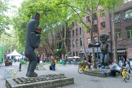 Seattle, Washington - June 30, 2018 : Pioneer Square Plaza in downtown Seattle, Washington, featuring Iron Pergola and Tlingit Indian Totem