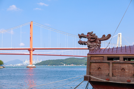 Namhae, South Korea - July 29, 2018 : Namhae Bridge and Yi Sun-sin turtle ship in Namhae County, South Gyeongsang Province Editorial