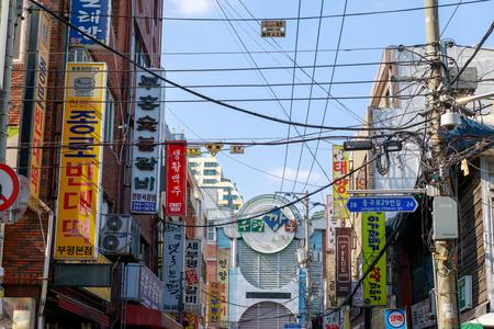 Busan, South Korea - Aug 5, 2018 : View of Bupyeong Kkangtong Market with various restaurant signages in Busan city