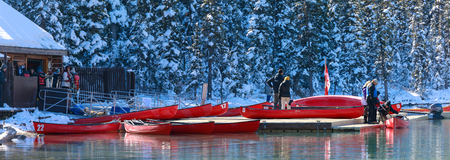Alberta, Canada - October 7, 2018 : Red canoes at Lake Louise with rocky mountain in Banff national park
