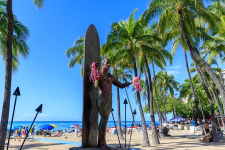 "Honolulu, Hawaii - Dec 23, 2018 : Duke Kahanamoku iconic statue. Duke is considered ""The father of modern surfing"", a master of swimming, surfing and outrigger canoe paddling Editorial"