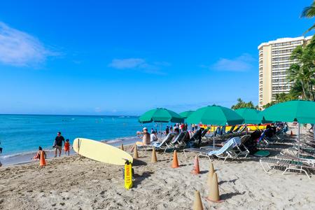 Honolulu, Hawaii - Dec 25, 2018 : View of busy Oahu Waikiki beach at daytime Editorial