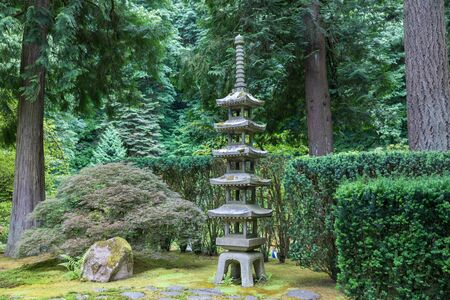 Inside a peaceful japanese garden, a Japanese pagoda rock statue in Portland, Oregon Stok Fotoğraf
