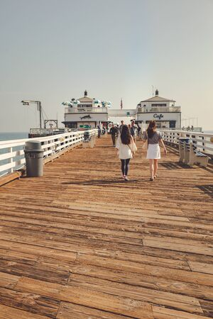 Malibu, California - February 17, 2020 : People walking on the Malibu Pier