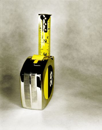 architect tools: Steel 25 foot tape measure, with partial rule showing Stock Photo