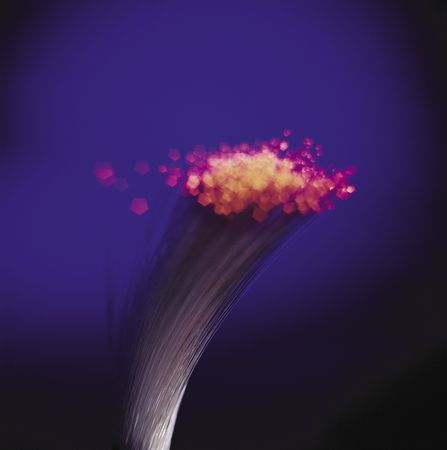 Closeup detail of a fiber optic bundle with glowing red tips. Imagens