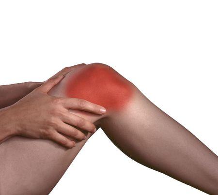 artrite: Dolori artritici alle articolazioni del ginocchio, le mani strofinando il dolore. Archivio Fotografico