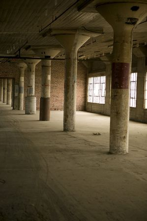 Interior space and support columns in an old warehouse.